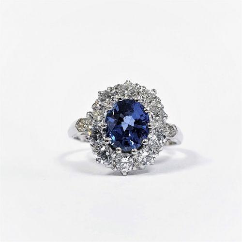 Cuttings Jewellers and Pawnbrokers, womens luxury silver oval ring with thick diamond outline and a blue sapphire stone