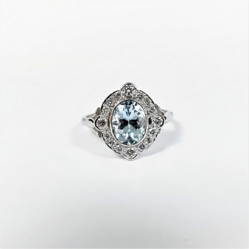 Cuttings Jewellers and Pawnbrokers, womens luxury silver ring with diamond oval setting and pale blue diamond stone