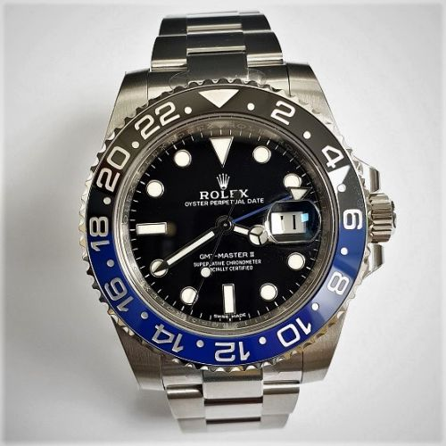 Cuttings Jewellers and Pawnbrokers, silver mens luxury Rolex watch, black and blue rim, black face